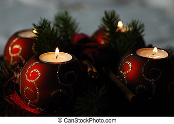 four advent candle - four colorfully decorated for Christmas...