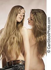 Girl's game - Portrait of young girls flirting with each...