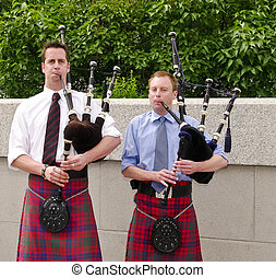 Bagpipe Players - Bagpipe duo in full dress playing in...