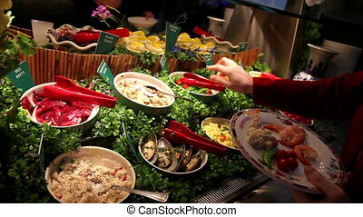 Seafood buffet - People taking food from a buffet