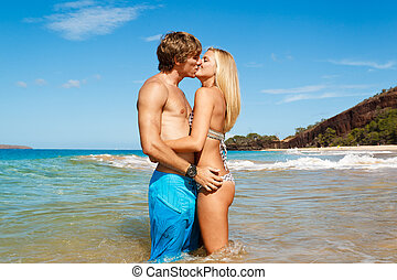 Young Couple on Tropical Beach - Attractive Young Couple...
