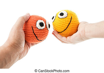 Two smileys in woman and man hands - Two crochet smileys in...