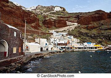 Oia village of Santorini island - Old port of Amoudi at Oia...