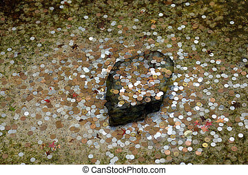 coins in pond - many japanese yen coins in zen garden pond,...