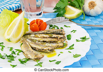 Marinated anchovies in the dish with lemon