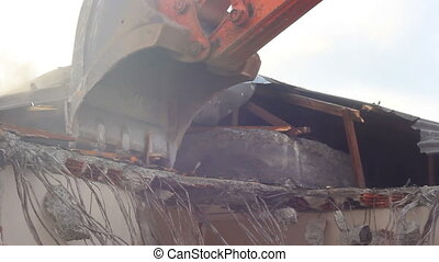 Building demolition, excavator and twisted rebars