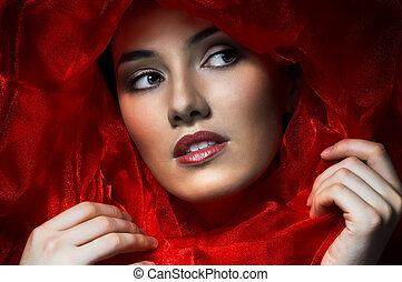 beauty portrait - beautiful girl in the red fabric