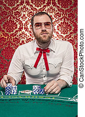Man Playing Blackjack, Glasses - A man wearing glasses, a...