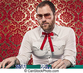 Confident Man Gambling - A man wearing glasses, a white...