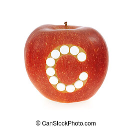 Red apple with vitamin c pills over white background - concept