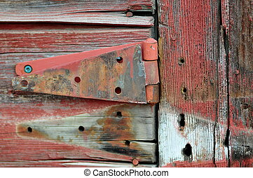 Broken Hinge - broken and rusted hinge hanging on an old...