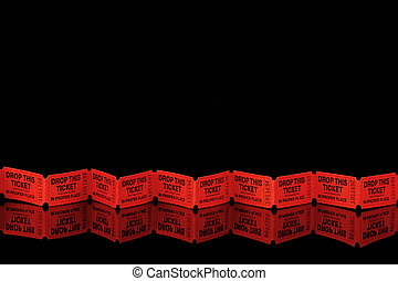 Red tickets on black - Row of red tickets on a black...