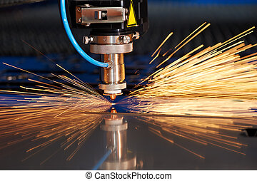 Laser cutting of metal sheet with sparks - Industrial Laser...