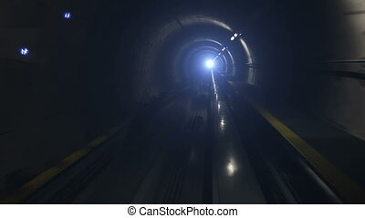 Moving train in subway tunnel, cabin view