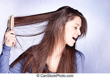 bad hair day - woman frustrated with her hair