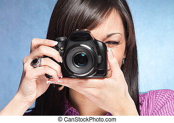 girl wit camera - girl take a photo with digital camera