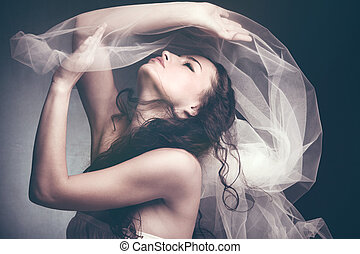 fantasy beauty - beautiful young woman play with white veil...