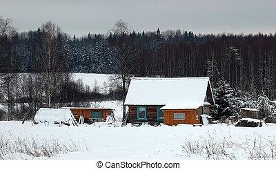 Typical Russian log house. - Typical Russian log house near...