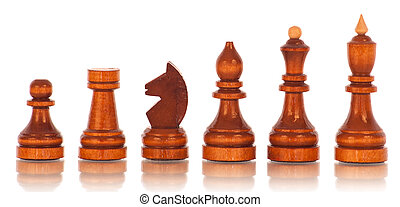 Chess. a group of black wooden chess pieces on a white...