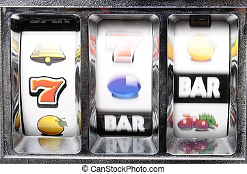 Playing slot machine : rollers rotating for jackpot