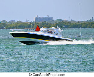 Speeding Fishing Boat - A fishing boat powered by outboard...