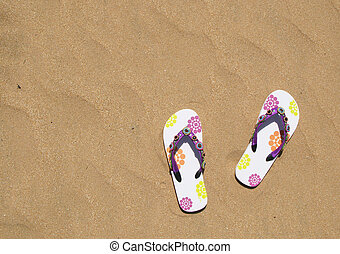 Trendy flip-flops on the sand