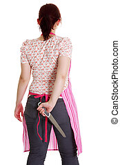 Housewife in pink apron with knife behind her back .