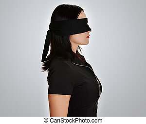 Blindfold business woman, over grey background