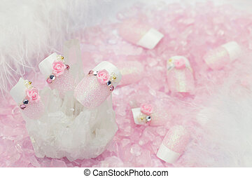 nail - I put nails on rose quartz and I took it for a...