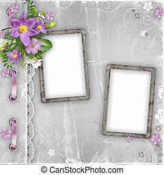 vintage paper photo frames with spring flowers on textured background