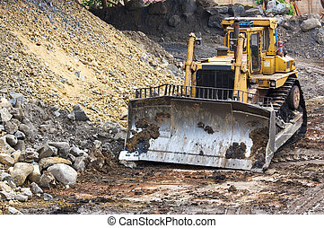 Bulldozer machine doing earthmoving work in mining