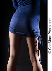 Blue Mini Skirt - Sexy legs with stockings on black...