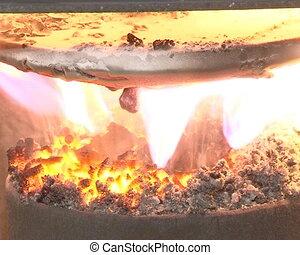 burning straw pellets - closeup of burning straw pellets in...