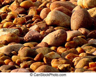 Orange and Brown Pebbles - Assortment of orange and brown...