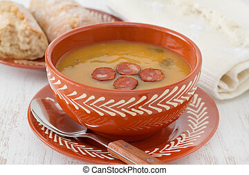 cream soup with cut sausage in the bowl