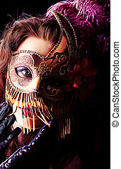 incognito - Portrait of an attractive woman in mask posing...