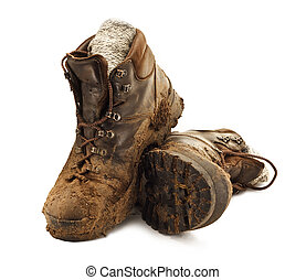 Muddy Trekking Boots - Pair of dirty brown walking boots...