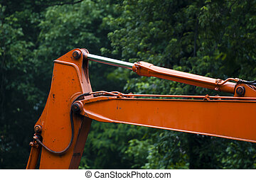 Hydraulic Arm on an Excavator - Close up of an orange...