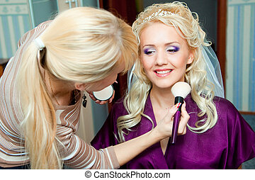 Morning of bride - The beautiful bride during make-up at...