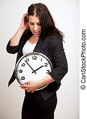 Young Professional Holding a Clock