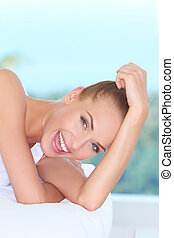 Beautiful high-spirited woman laughing - Closeup facial...