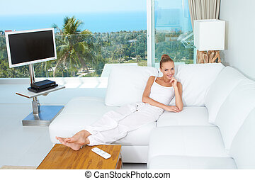 Luxury of a tropical lifestyle - A beautiful woman relaxes...