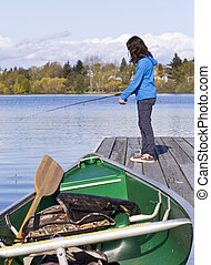 Fishing Boat on Dock - Fishing boat on dock with young girl...