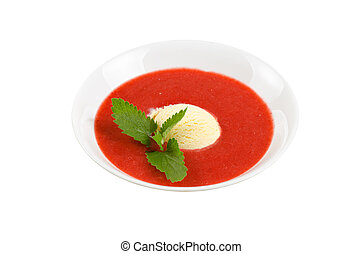 Strawberry soup with ice cream and mint on a white