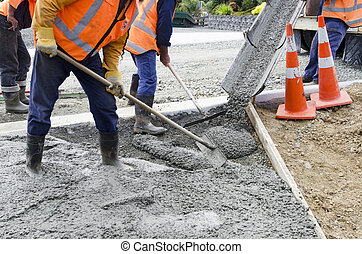Road Working - Concrete - Builders pouring cement during...