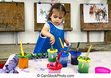 Childhood - Art - Adorable little girl painting and drawing