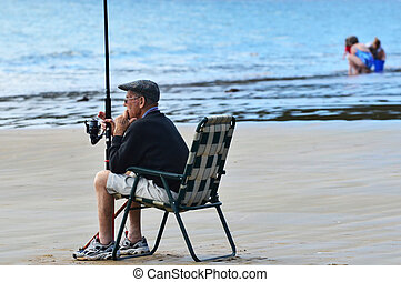 Sea Sport - Fishing - A very old man fishing a the beach.