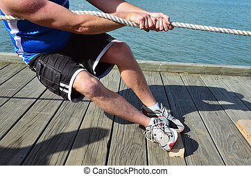 Sport - Rope Pulling - Close up of body hands pulling a...