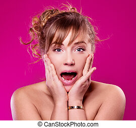 shocked woman - shocked young woman, isolated against purple...