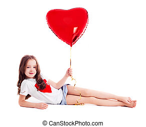 girl with a balloon - cute six year old girl with a big red...